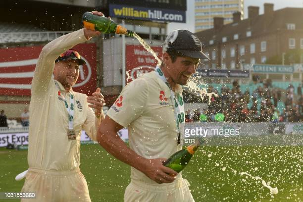 England's captain Joe Root sprays champagne on Alastair Cook after winning the fifth Test cricket match and the series 41 against India at The Oval...