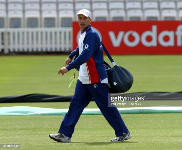 England's captain Nasser Hussain walks across the pitch as Sri Lanka train at Lords.