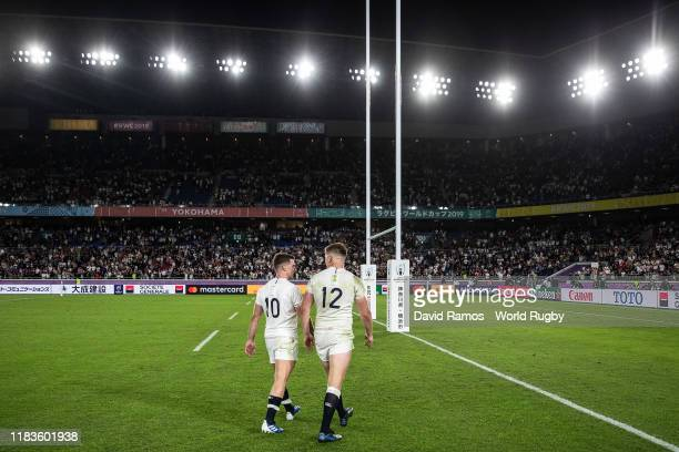 England's captain Owen Farrel walks onto the pitch next to his team mate George Ford following victory during the Rugby World Cup 2019 SemiFinal...