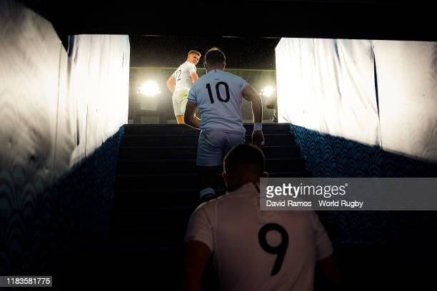 England's captain Owen Farrell Ben Youngs and George Ford of England walk up the steps from the dressing room onto the field of play during the Rugby...