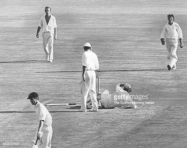 England's captain Ray Illingworth looks down at Australian batsman Terry Jenner after he was hit by a bumper from English bowler John Snow at the...