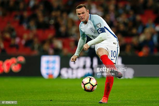 England's captain Wayne Rooney passes the ball during the World Cup 2018 football qualification match between England and Malta at Wembley Stadium in...