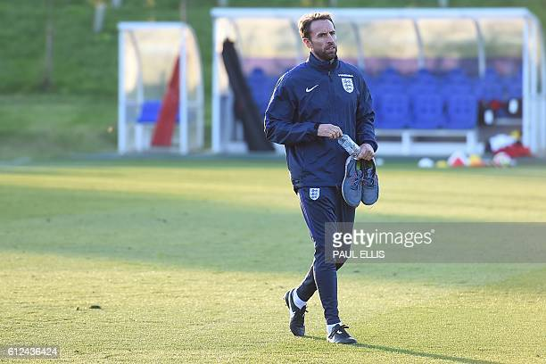 England's caretaker manager Gareth Southgate leaves the pitch at the end of a training session at England's training facility at St George's Park in...