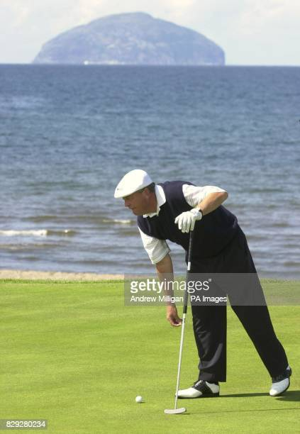 England's Carl Mason on the fourth green with Ailsa Craig in the background during his third round at the Senior British Open Championship Turnberry