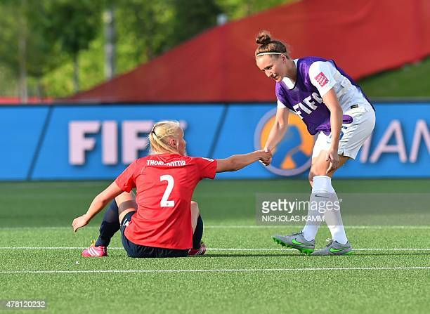 England's Casey Stoney shakes hand with Norway's Maria Thorisdottir after their 2015 FIFA Women's World Cup Round of 16 football match at Lansdowne...