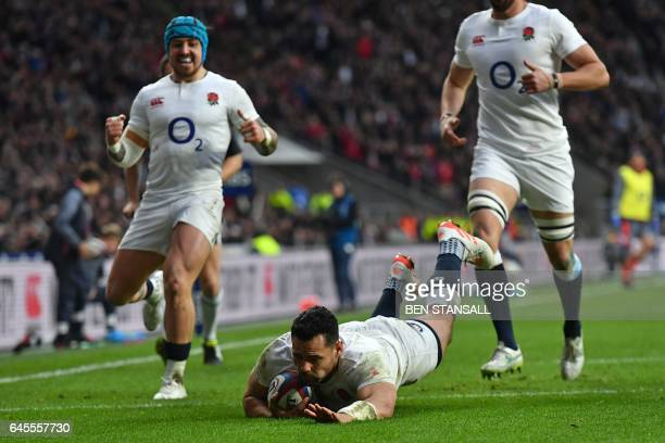 England's centre Ben Te'o dives over the line to score a try during the Six Nations international rugby union match between England and Italy at...