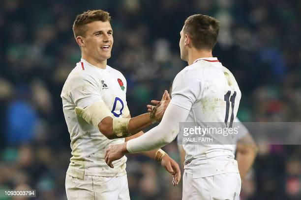 England's centre Henry Slade and England's wing Jonny May shakes hands on the final whistle in the Six Nations international rugby union match...