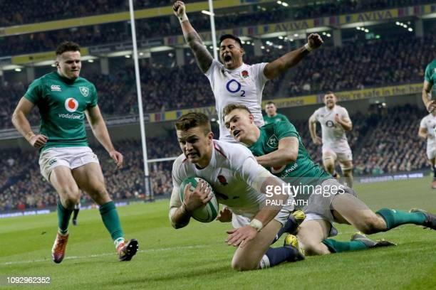 England's centre Henry Slade dives over the line to score a try during the Six Nations international rugby union match between Ireland and England at...