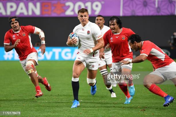 England's centre Henry Slade runs with the ball during the Japan 2019 Rugby World Cup Pool C match between England and Tonga at the Sapporo Dome in...