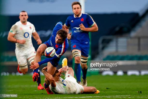 England's centre Henry Slade tackles France's Pierre-Louis Barassi during the final of the Autumn Nations Cup international rugby union series...