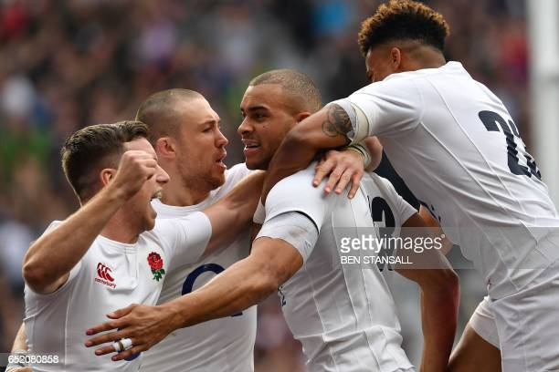 England's centre Jonathan Joseph celebrates after scoring his team's first try during the Six Nations international rugby union match between England...