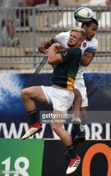 England's centre Jordan Olowofela clashes with South Africa winger Tyrone Green during the U20 World Rugby union Championship semifinal match between...