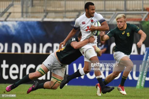 England's centre Jordan Olowofela vies with South Africa's n°8 Muller Uys and South Africa's winger Tyrone Green during the U20 World Rugby union...