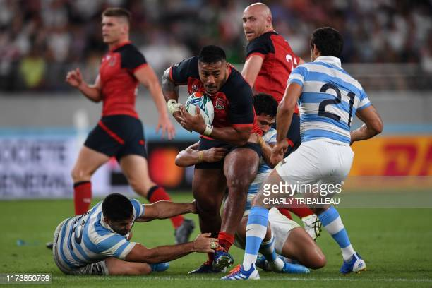 England's centre Manu Tuilagi runs with the ball during the Japan 2019 Rugby World Cup Pool C match between England and Argentina at the Tokyo...