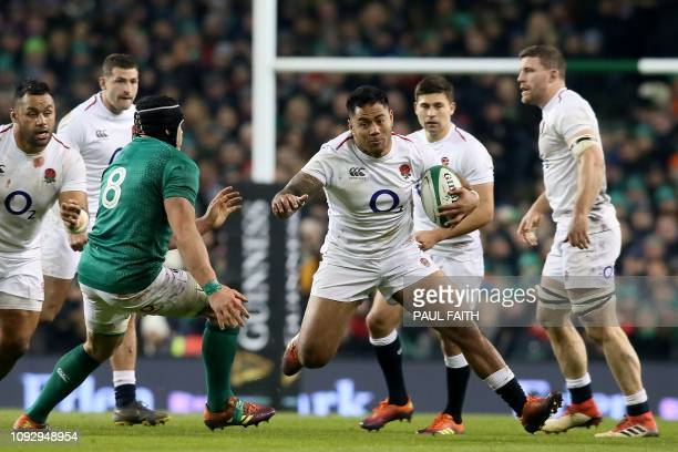 TOPSHOT England's centre Manu Tuilagi runs with the ball during the Six Nations international rugby union match between Ireland and England at the...