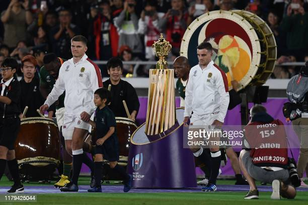 England's centre Owen Farrell and England's flyhalf George Ford walk onto the pitch for the Japan 2019 Rugby World Cup final match between England...