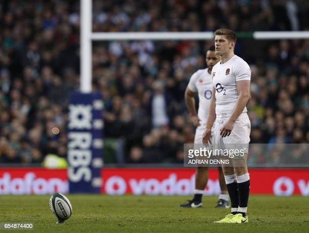 England's centre Owen Farrell converts a penalty during the Six Nations international rugby union match between Ireland and England at the Aviva...