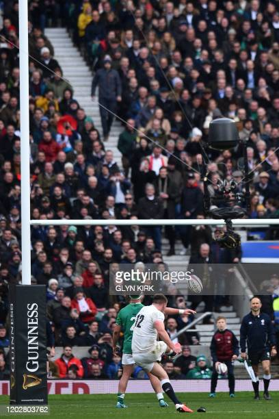 England's centre Owen Farrell kicks a penalty during the Six Nations international rugby union match between England and Ireland at the Twickenham,...