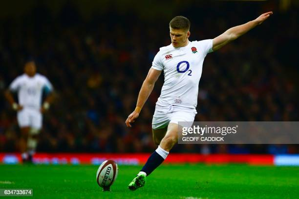England's centre Owen Farrell kicks a penalty during the Six Nations international rugby union match between Wales and England at the Principality...