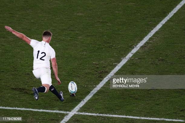 England's centre Owen Farrell scores a penalty during the Japan 2019 Rugby World Cup final match between England and South Africa at the...