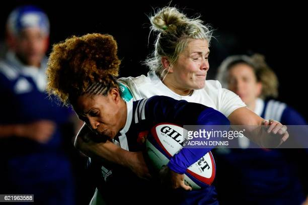 TOPSHOT England's centre Rachael Burford tackles France's centre Rose Thomas during the Old Mutual Wealth Series international women's rugby union...