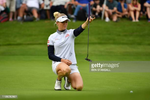 England's Charley Hull lines up a putt on the 3rd green on the third day of the 2019 Women's British Open golf championship at Woburn Golf Club, in...