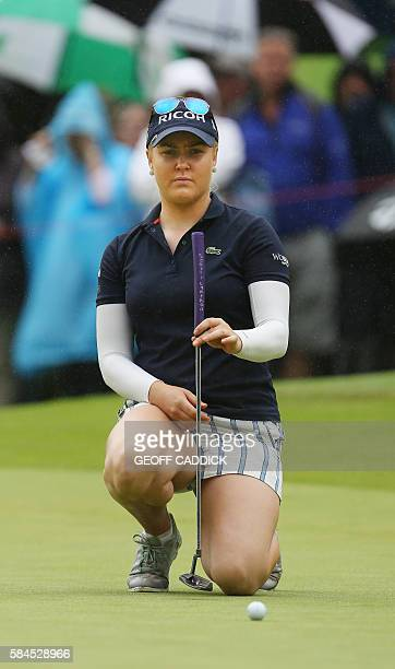 England's Charley Hull lines up a putt onthe 15th green on the second day of the 2016 Women's British Open Golf Championships at Woburn Golf Club in...