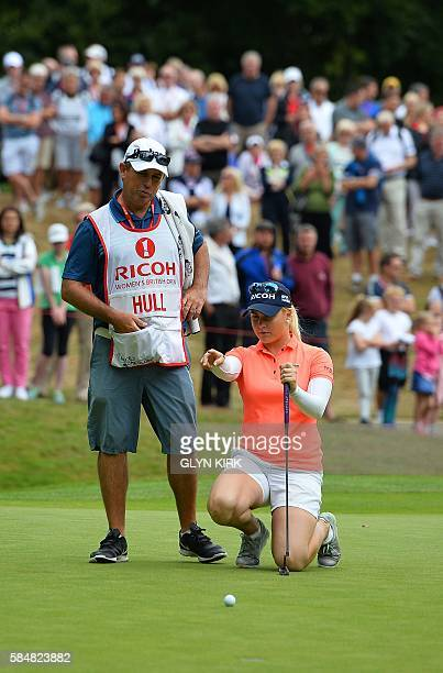 England's Charley Hull lines up her putt on the 17th green during the final day of the 2016 Women's British Open Golf Championships at Woburn Golf...