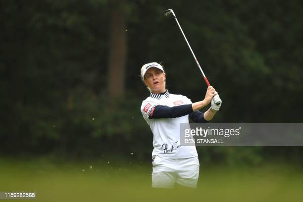 England's Charley Hull plays her approach to the 3rd green on the third day of the 2019 Women's British Open golf championship at Woburn Golf Club,...
