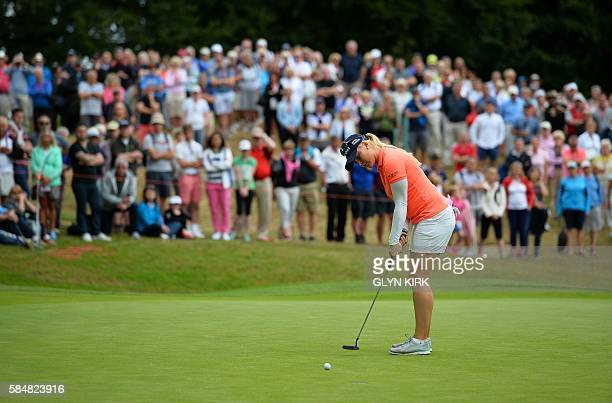 England's Charley Hull putts on the 17th green during the final day of the 2016 Women's British Open Golf Championships at Woburn Golf Club in...