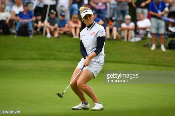 England's Charley Hull reacts to missing a putt on the 3rd green on the third day of the 2019 Women's British Open golf championship at Woburn Golf...