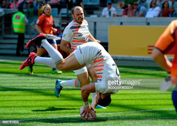England's Charlie Hayter does a somersault as he scores a try against during the World Rugby Sevens Series match England versus Argentina on December...