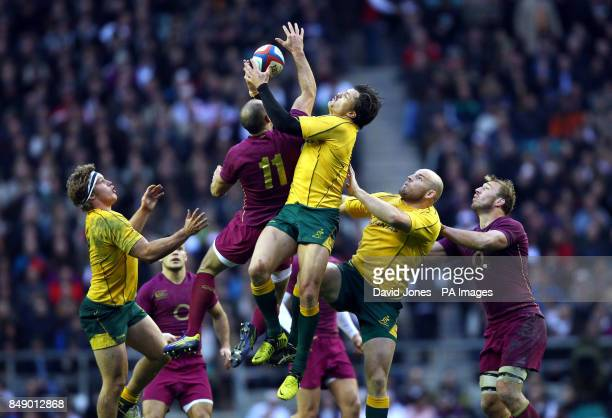 England's Charlie Sharples and Australia's Adam Ashley Cooper challenge for a high ball during the QBE International at Twickenham London