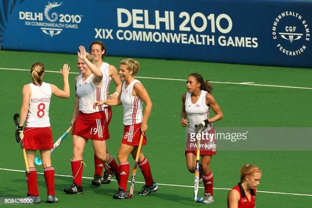 England's Charlotte Craddock celebrates scoring a goal against Wales in the hockey preliminary round match during Day Two of the 2010 Commonwealth...
