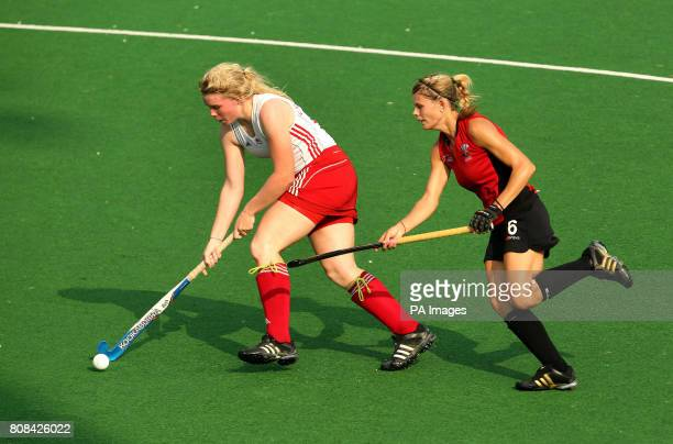 England's Charlotte Craddock in action against Wales' Alys Brooks in the hockey preliminary round match during Day Two of the 2010 Commonwealth Games...
