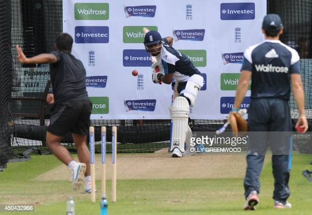 England's Chris Jordan bats during a practice session at Lords cricket ground in London on June 11, 2014 ahead of the first Test match between...