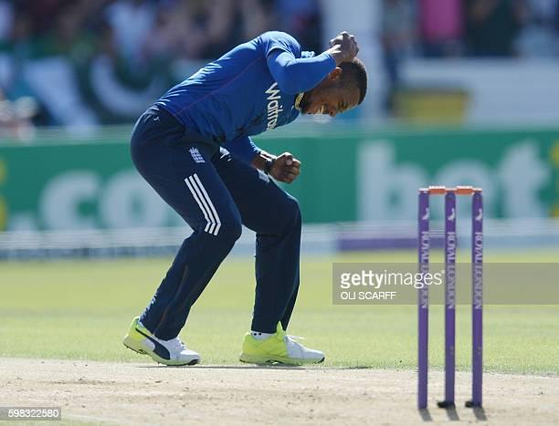 England's Chris Jordan celebrates after dismissing Sharjeel Khan during the fourth oneday international cricket match between England and Pakistan at...