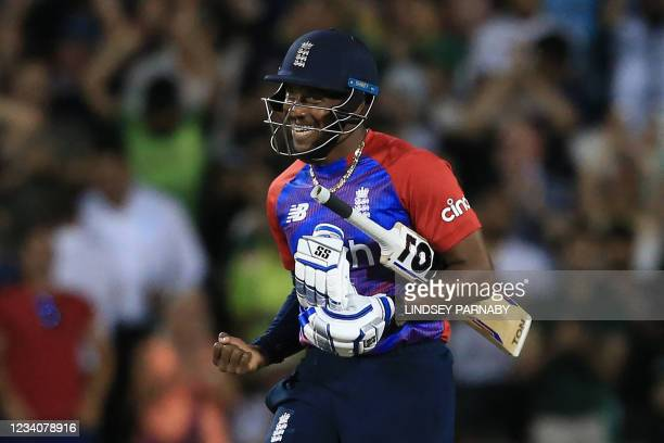England's Chris Jordan celebrates victory during the third T20 international cricket match between England and Pakistan at Old Trafford Cricket...