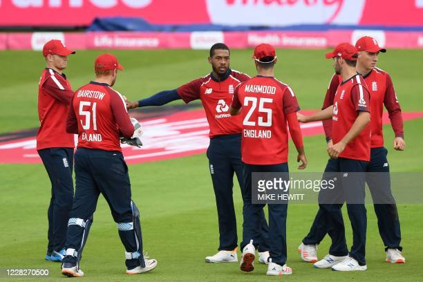 England's Chris Jordan celebrates with teammates after taking the wicket of Pakistan's Shoaib Malik during the international Twenty20 cricket match...