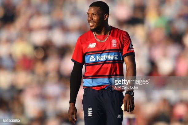 England's Chris Jordan smiles during the T20 international cricket match between England and South Africa at The Ageas Bowl in Southampton on the...