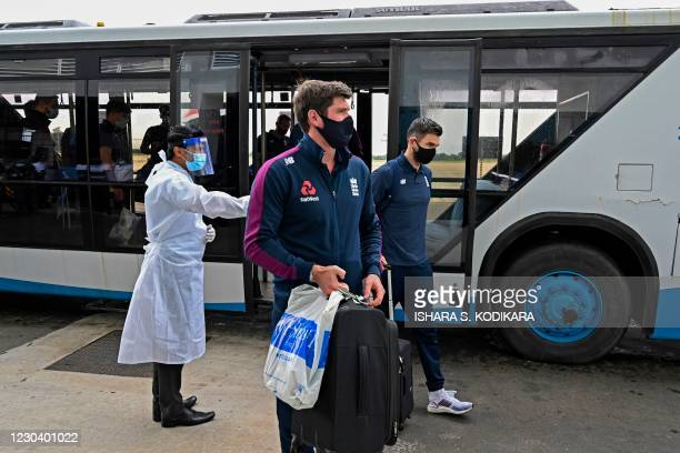 Englands Chris Woakes and James Anderson arrive at the Rajapaksa international airport in Mattala on January 3 as England's cricket team returned to...