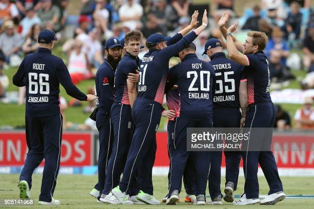 England's Chris Woakes and teammates celebrate the wicket of New Zealand's Mark Chapman during the second one-day international cricket match between...