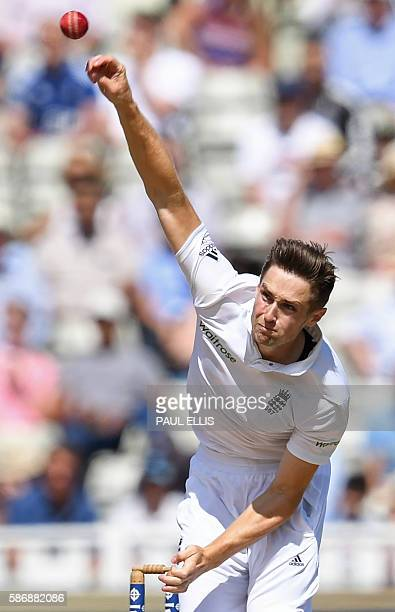 England's Chris Woakes bowls during play on the final day of the third test cricket match between England and Pakistan at Edgbaston in Birmingham on...