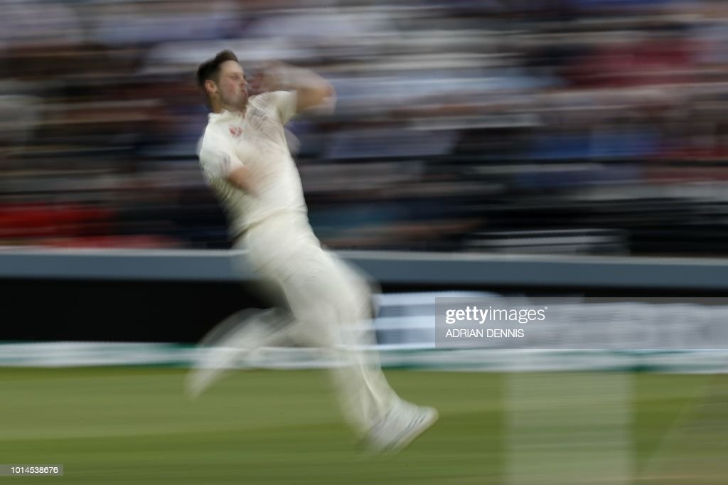 TOPSHOT - England's Chris Woakes bowls on the second day of the second Test cricket match between England and India at Lord's Cricket Ground in London on August 10, 2018. (Photo by Adrian DENNIS / AFP) / RESTRICTED