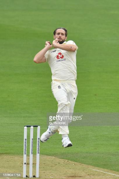 England's Chris Woakes bowls on the second day of the second Test cricket match between England and Pakistan at the Ageas Bowl in Southampton,...