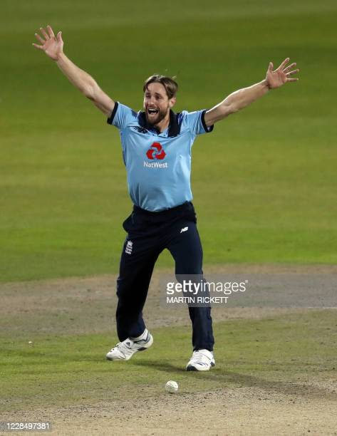England's Chris Woakes celebrates the dismissal of Australia's Marnus Labuschagne for 48 runs during the one-day international cricket match between...