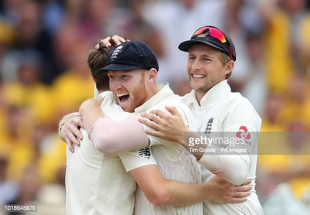 England's Chris Woakes celebrates the wicket of India's Cheteshwar Pujara with teammates Ben Stokes and Joe Root during day one of the Specsavers...