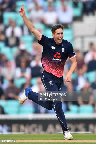 England's Chris Woakes celebrates the wicket of West Indies' Shai Hope for 11 during the fourth OneDay International cricket match between England...