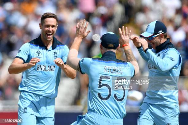TOPSHOT England's Chris Woakes celebrates with England's Ben Stokes after dismissing Australia's Peter Handscomb for four during the 2019 Cricket...