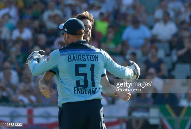 England's Chris Woakes celebrates with teammate Jonny Bairstow after the dismissal of South Africa's Reeza Hendricksduring the first one day...